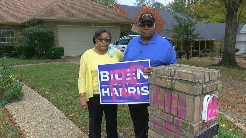 Bill and Anna Brown stand in their front yard on Monday morning with their vandalized campaign...