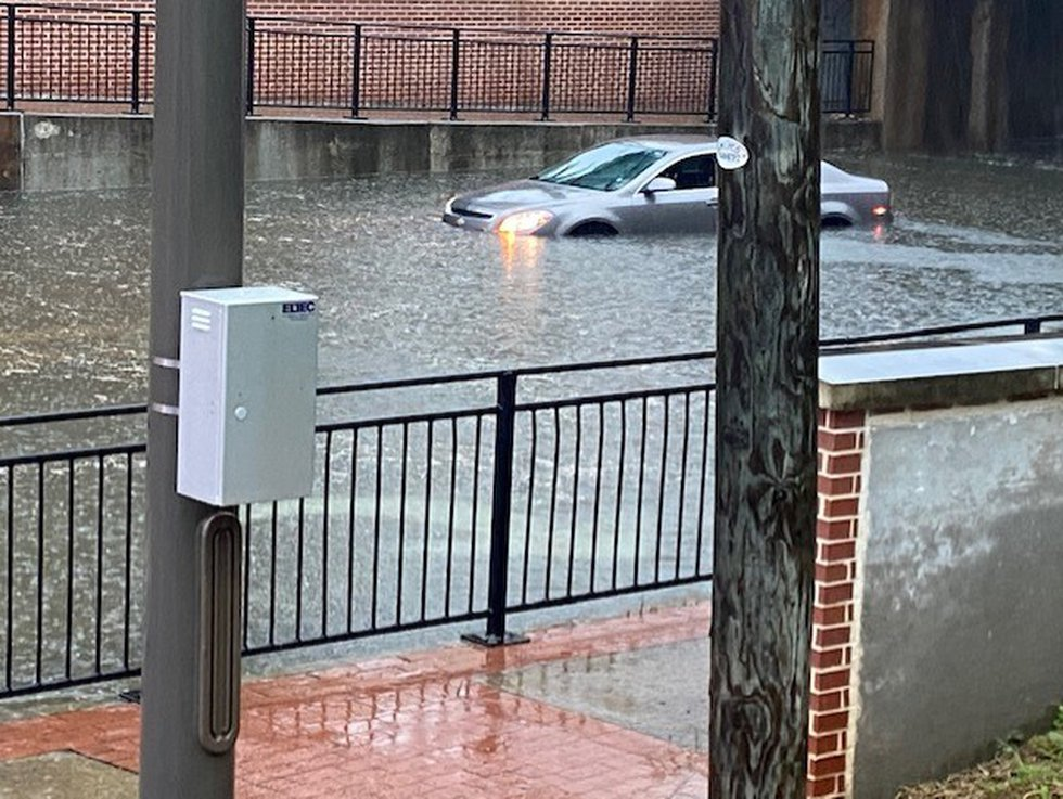 Car stranded in floodwaters