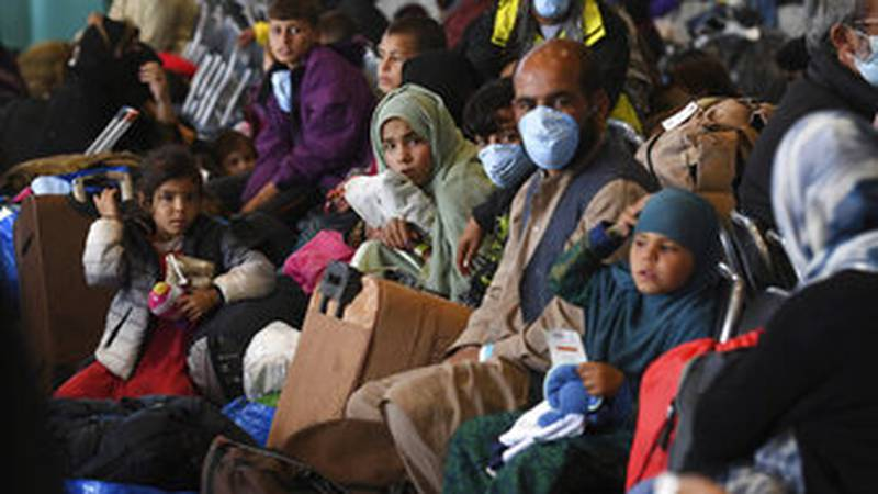 Afghan refugees are processed inside Hangar 5 at theRamstein U.S. Air Base in Germany...